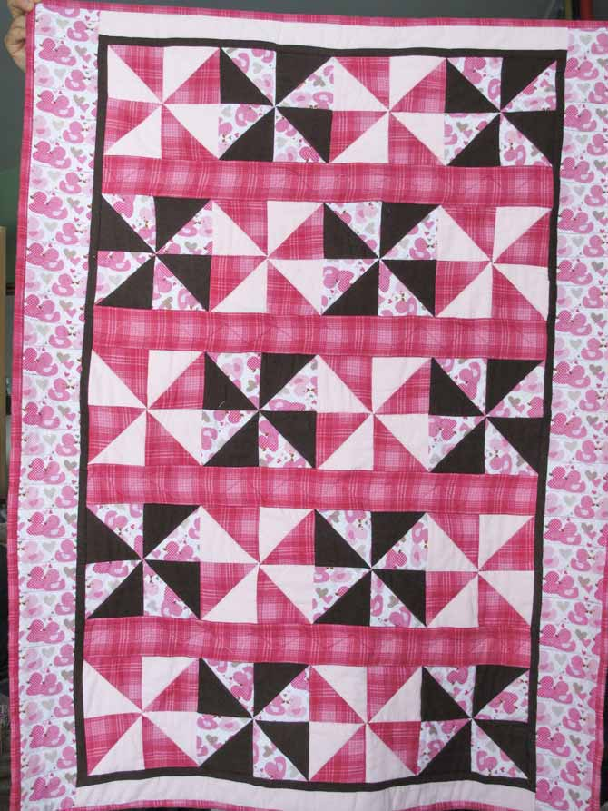 The baby girl quilt top made with propellers