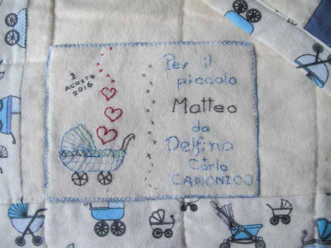 The embroidered label for the baby boy quilt. The baby's parents are primarily Italian, so it was fitting to express it in Italian.