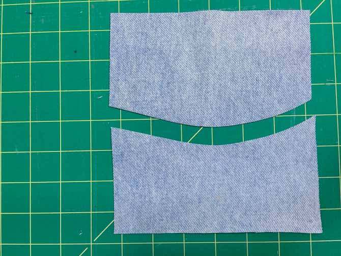 Cut a denim square in half with a gentle wave shape.