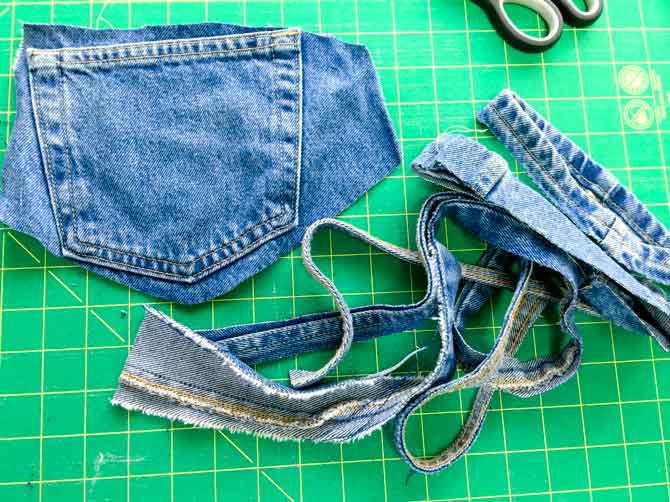 Jeans with seams and pockets cut out.