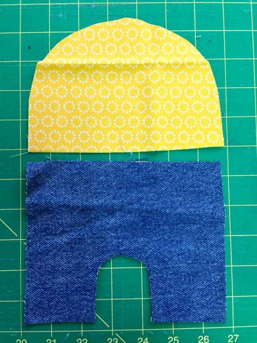 Cut out shapes for body and head of minion.