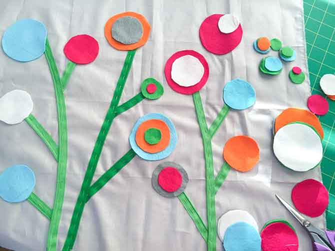 Layer wool felt circles at the end of the zipper stems to create flowers.