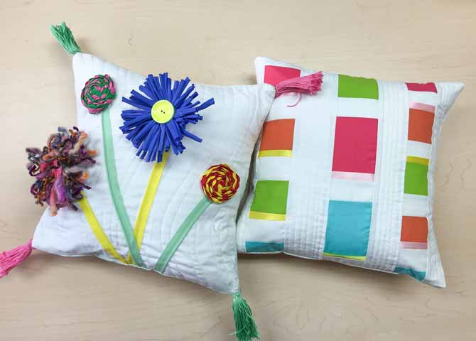 Zippers make great flower stems on modern quilted pillow