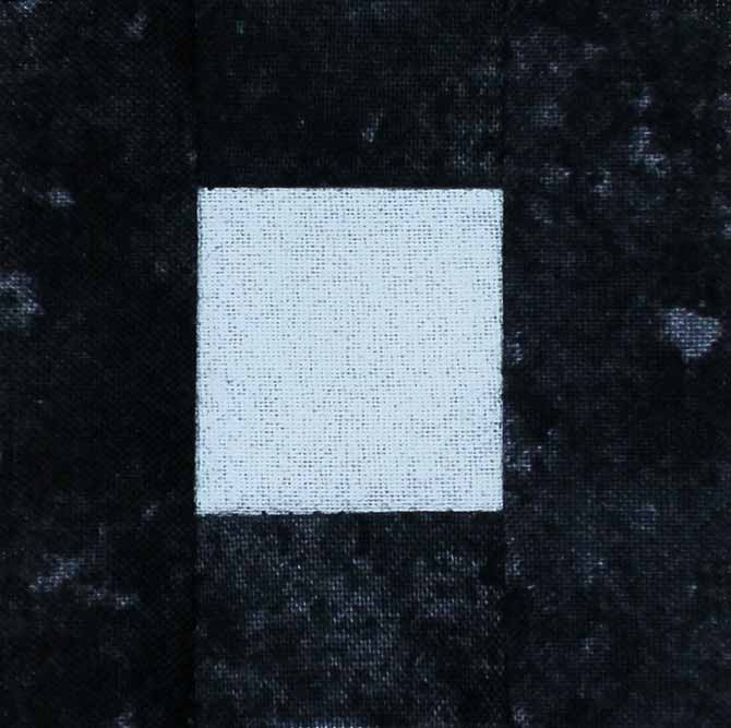Sew the black strips onto the center square.