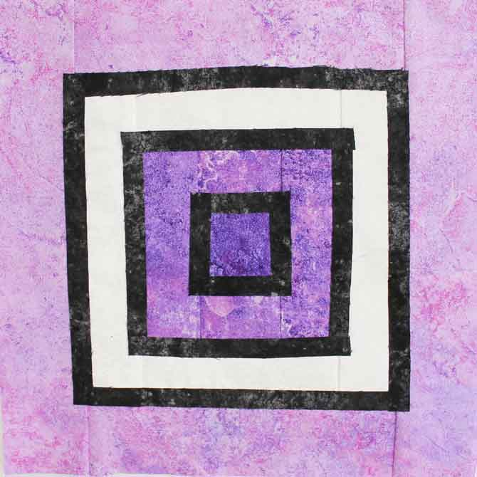 Stained glass quilt block with fused black fabric