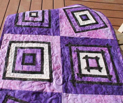 Modern stained glass wall hanging quilted and bound.