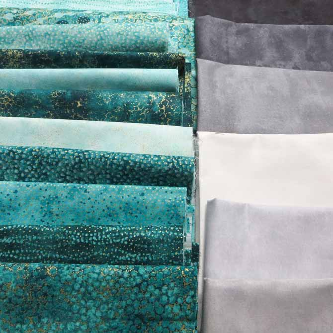 Northcott's Artisan Spirit Shimmer and Artisan Spirit Echoes in the Peacock colorway and Toscana fabrics in gray.