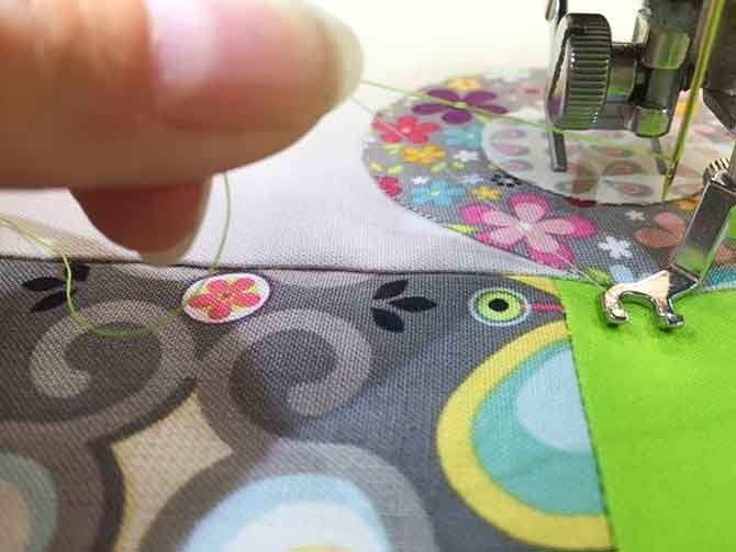 Bring the bobbin thread up to the top prior to free motion quilting.