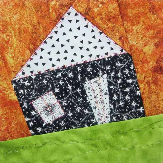 Improv house with decorative stitches #65, #2, #14 and #56 on the Pfaff Expression™ 4.2