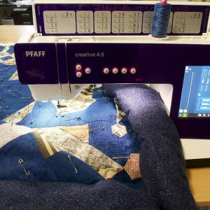 Quilt rolled and in machine