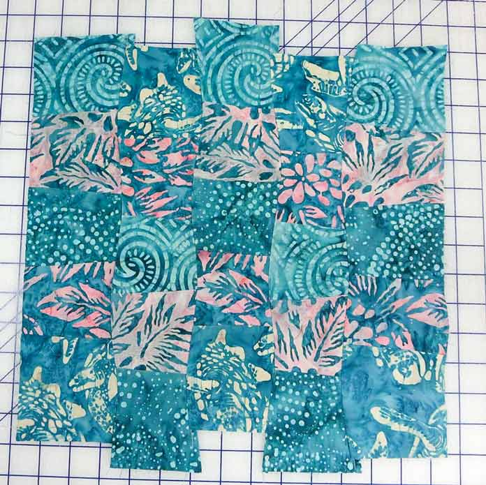 Arrange the segments, off-setting them a little for a more interesting design. Using Banyan Batiks Island Vibes fabrics to make a modern quilt, placemat, cushion cover etc.
