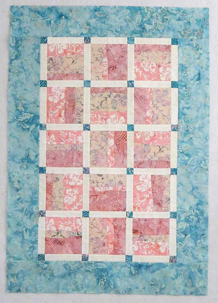 Baby quilt (or wall quilt) made with Banyan Batiks Island Vibes fabric