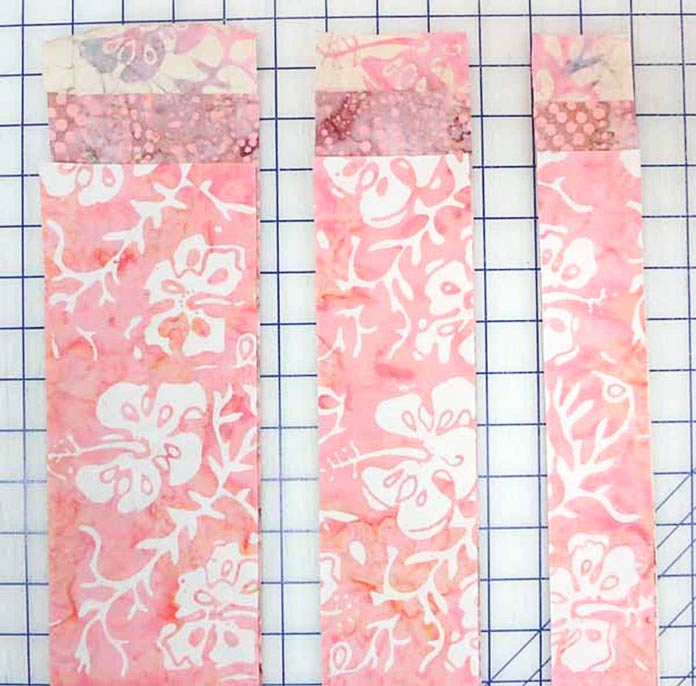 "Cut 4"", 3"" and 2"" strips from each fat quarter."