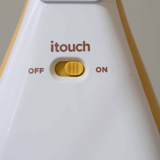 the button on heel of iron to turn iTouch technology on and off