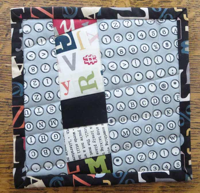 Use up leftover strip piecing for another mug mat.