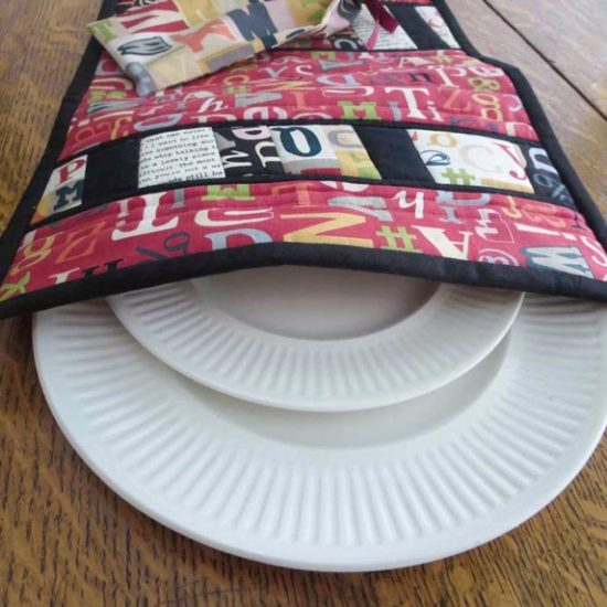 Finished Pull-out Plate Placemat showing plates in the back pocket