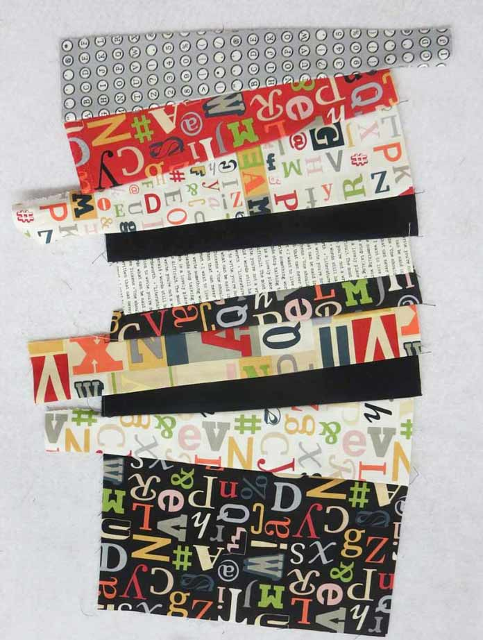 Leftover strips and scraps used to make a strip set