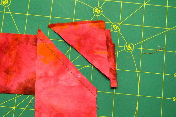 Sew binding strips with a diagonal seam and trim seam allowances.