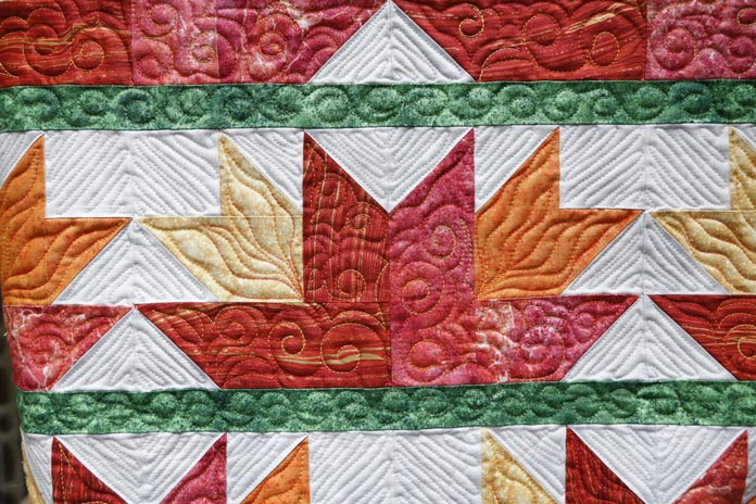 Up close shot of the front of my quilt with the flower blocks - quilting with the Husqvarna Viking Topaz 50