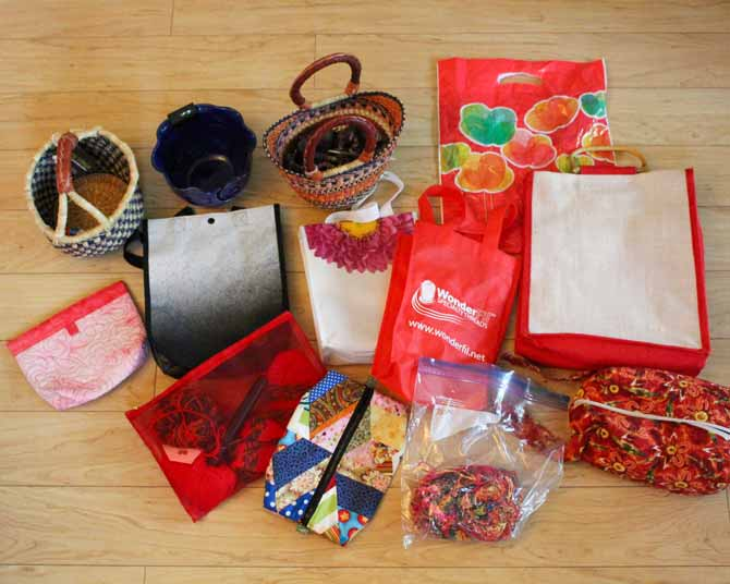 This is a collection of some of the many knitting project bags and baskets that I use