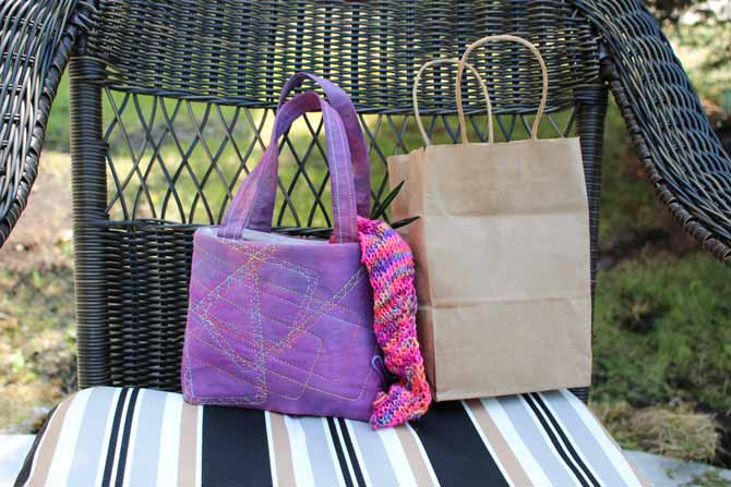 A pretty quilted knitting bag looks so much better than a plain brown paper bag - exploring free motion quilting using WonderFil Threads.