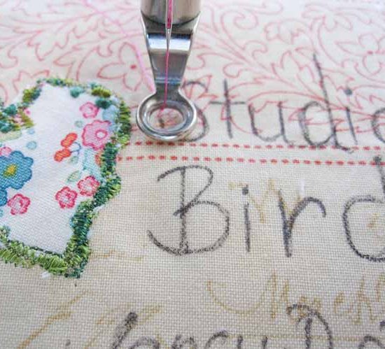 Machine set up to embroider a label for the Studio Bird mini quilt. WonderFil Specialty Threads.