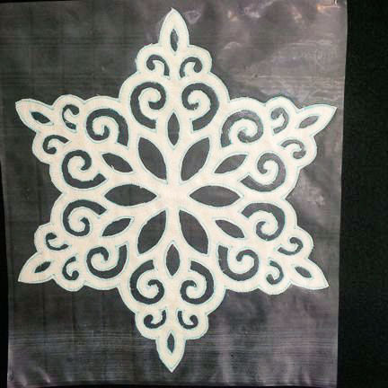 Lacy snowflake cut out