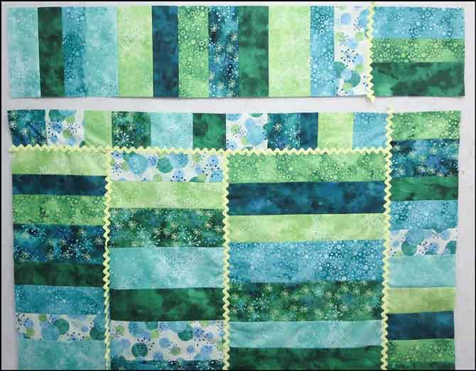 Sew units 1/2 to the top of the quilt.