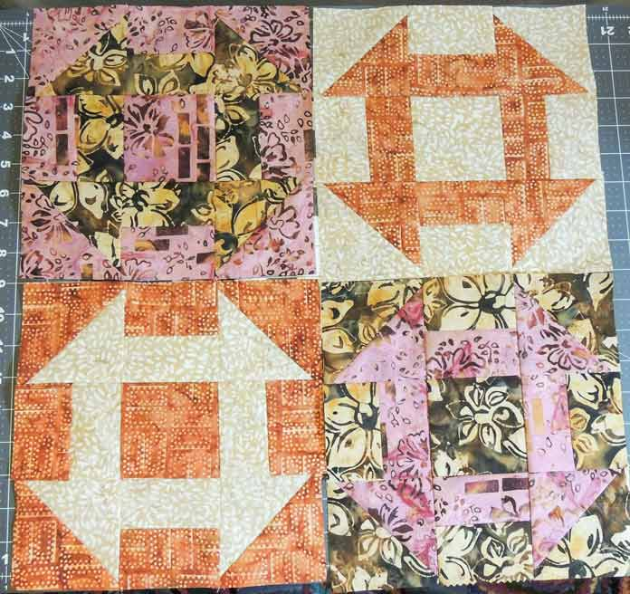 Four batik churn dash blocks
