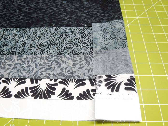All 5 enticing colorways of the Banyan Classics Collection are featured in the strip sets which are ready for cutting this quick and easy rail fence quilt.