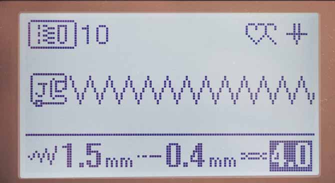 The LCD display on the Brother NQ900 shows the settings for the Utility Stitch #10, otherwise known as the zigzag stitch.