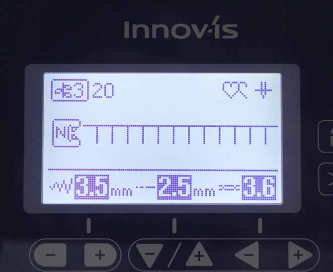 The LCD display showing the blanket stitch settings for the Brother NQ900's Utility Decorative Stitch #20.