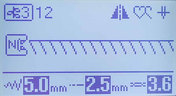 The LCD display showing the settings for Utility Decorative Stitch #12 on the Brother NQ900 sewing machine.