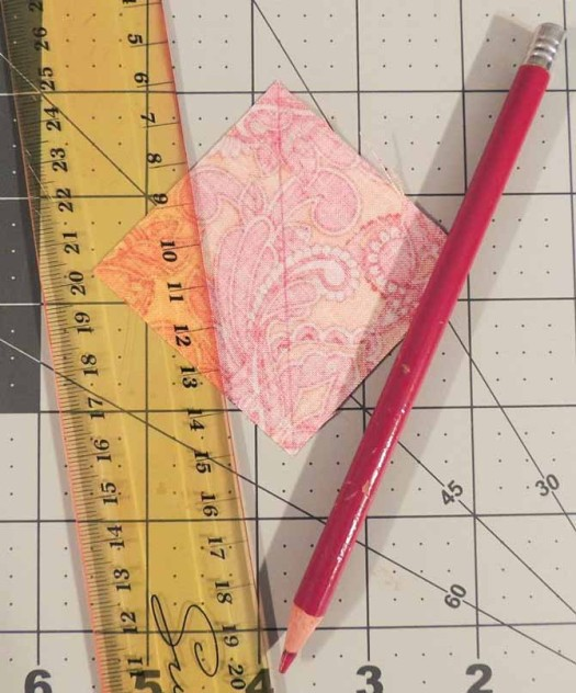 Mark diagonal line on back of background fabric square