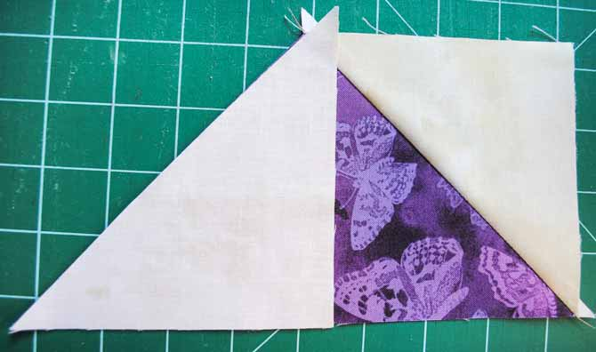 Lining up and sewing on the second small triangle