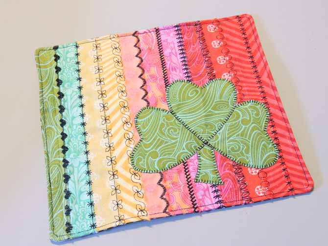 shamrock applique on stitch sampler from passport 3.0