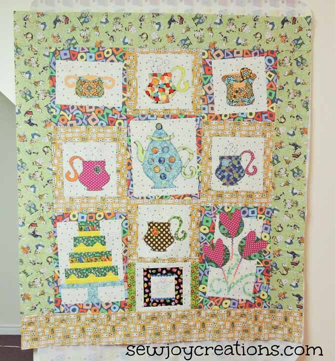This quilt is a product of a Pat Sloan challenge to create a quilt with her Madhatter Tea Party blocks.