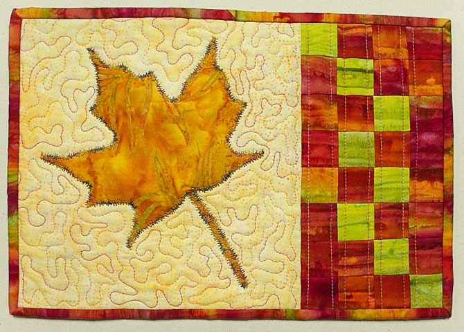 Finished maple leaf mug rug