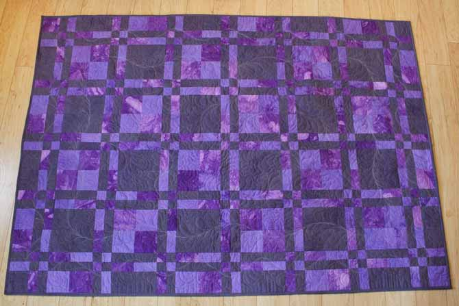 The lovely purple and greys hand dyed with Dylon Permanent Fabric dyes show up beautifully in Marina's grad quilt.