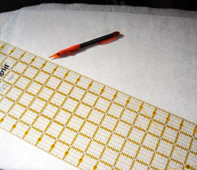 Marking the first quilting line across the pillow top