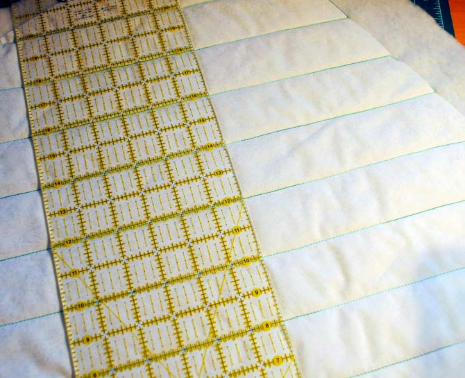 Marking the second group of quilting lines perpendicular to the first set.