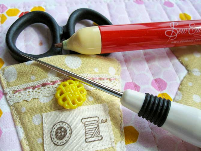 Mark the position of the cord in the scissor holder, and use a tailor's awl to create holes for the cord.