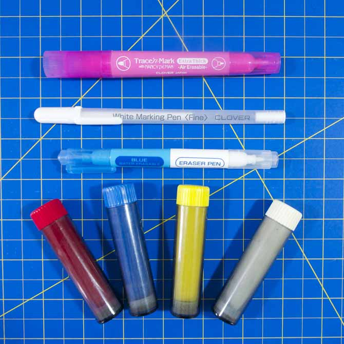 An array of marking pens and chalk