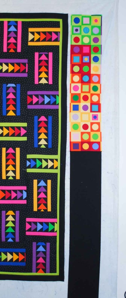 Measure the length of the quilt and cut the excess black fabric from the border