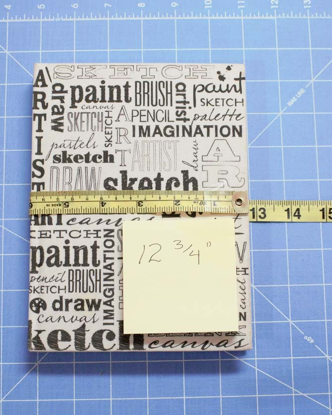 A tape measure is used to measure the full width of journal to make the paper pattern.