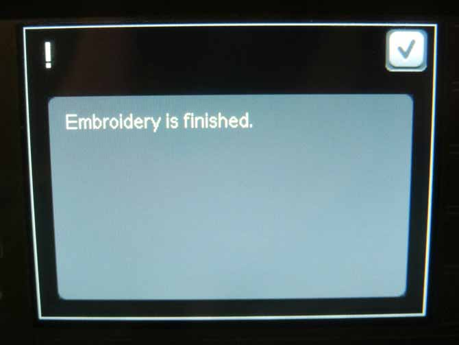 "The ""embroidery finished"" pop up on the creative 3.0 colour touch screen."