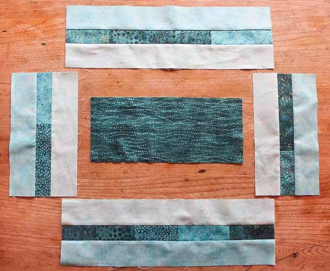 The pieced borders made from the Northcott Artisan Spirit fabrics are ready to be sewn to the center section of the placemat.