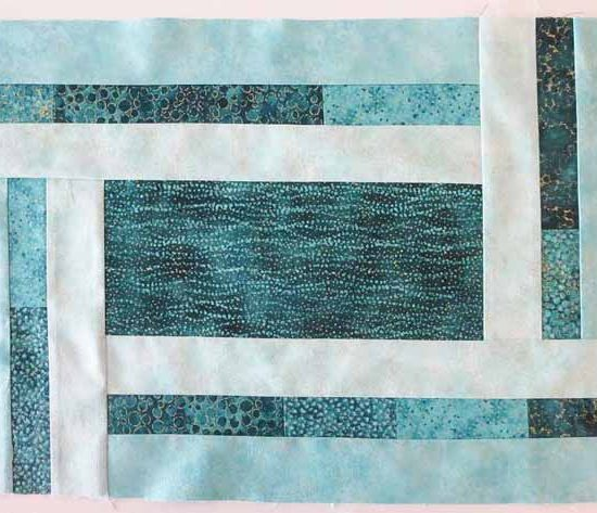 All of the borders on the placemat made with Northcott's Artisan Spirit fabrics have been sewn on.