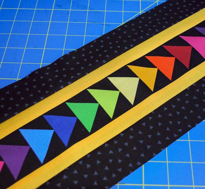 Sew one black strip to each side to make one finished strip set