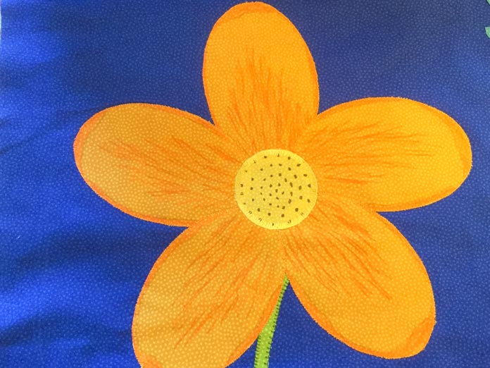 Our applique flower stitched with decorative stitches